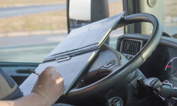 truck-driver filling out paperwork